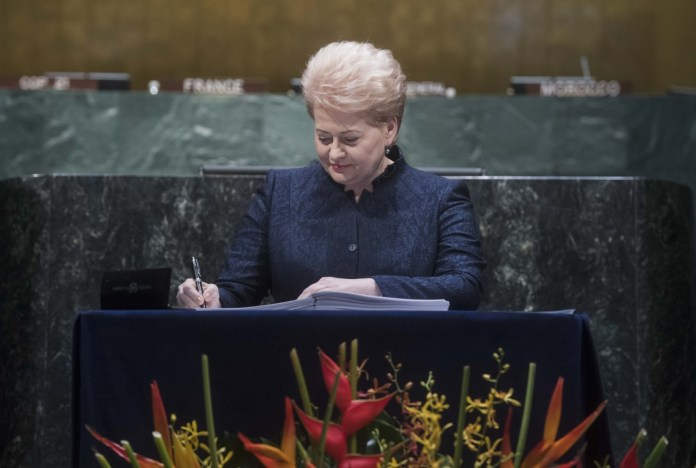 Shown here is Lithuanian President, Dalia Grybauskaite, signing the Paris Agreement at UN Headquarters in New York on April 22. More than 165 Member States were expected to attend the signing ceremony, including an estimated 60 Heads of State and Heads of Government. Besides Lithuania, the Baltic States of Estonia and Latvia were also expected to sign this historic document. UN Photo: Ananda Voisard.
