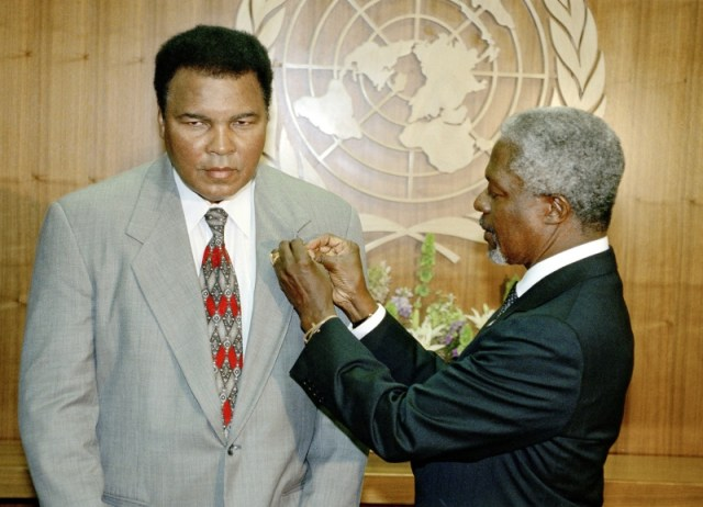 "Pictured is former UN Secretary-General Kofi Annan (on the right) pinning a peace dove on the lapel of former three time World Heavyweight Boxing Champion Muhammad Ali, proclaiming him a UN ""Messenger of Peace"" on September 15, 1998. UN Photo/Eskinder Debebe."