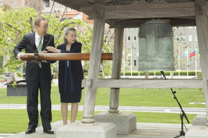 Pictured at the UN Peace Bell is the UN Secretary-General Ban Ki-moon, together with his wife Yoo Soon-taek. The Secretary-General rang the UN Peace Bell at a special ceremony to mark the return of the Peace Bell from the Rose Garden to its original location in the Japanese Peace Garden during the UN renovation under the Capital Master Plan in May 2015. UN Photo/Mark Garten.