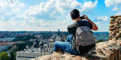 with-backpack-taking-photo-of-cathedral-square-in-the-old-town-in-vilnius