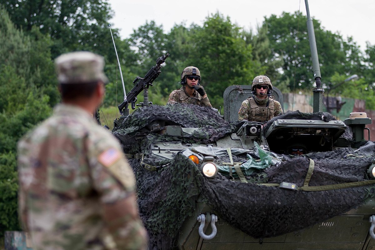 A 2nd Cavalry Regiment Stryker crew queues for ammunition distribution during a training event during Saber Strike 18 in Powidz, Poland, on June 1. Four of their vehicles collided on June 7 in Lithuania. (Capt. Jeku Arce/Army)