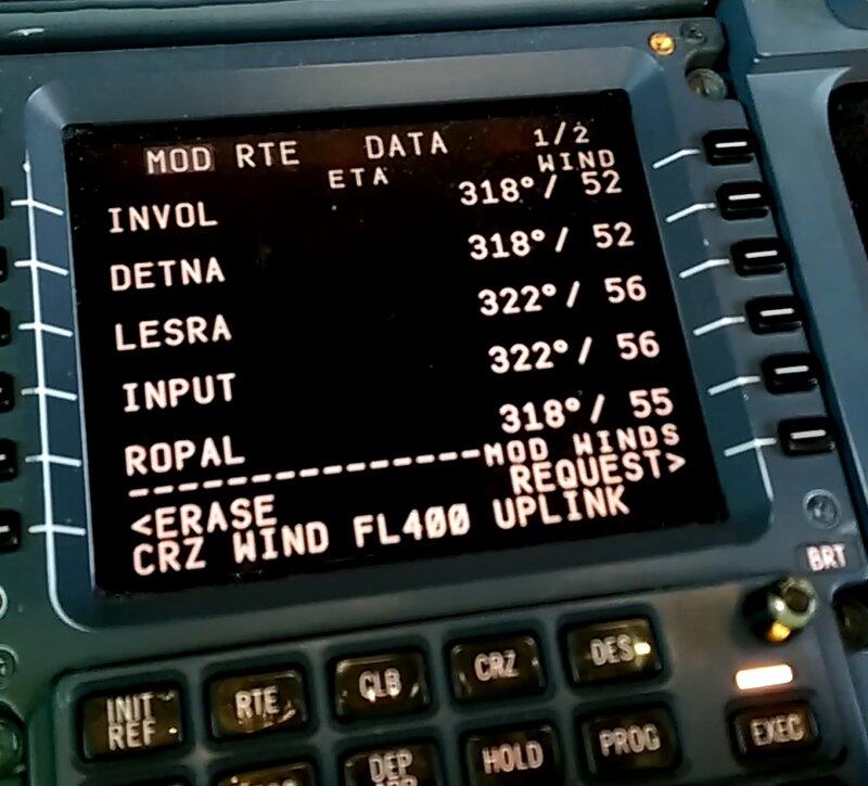 Pilot entering wind input to flight computer