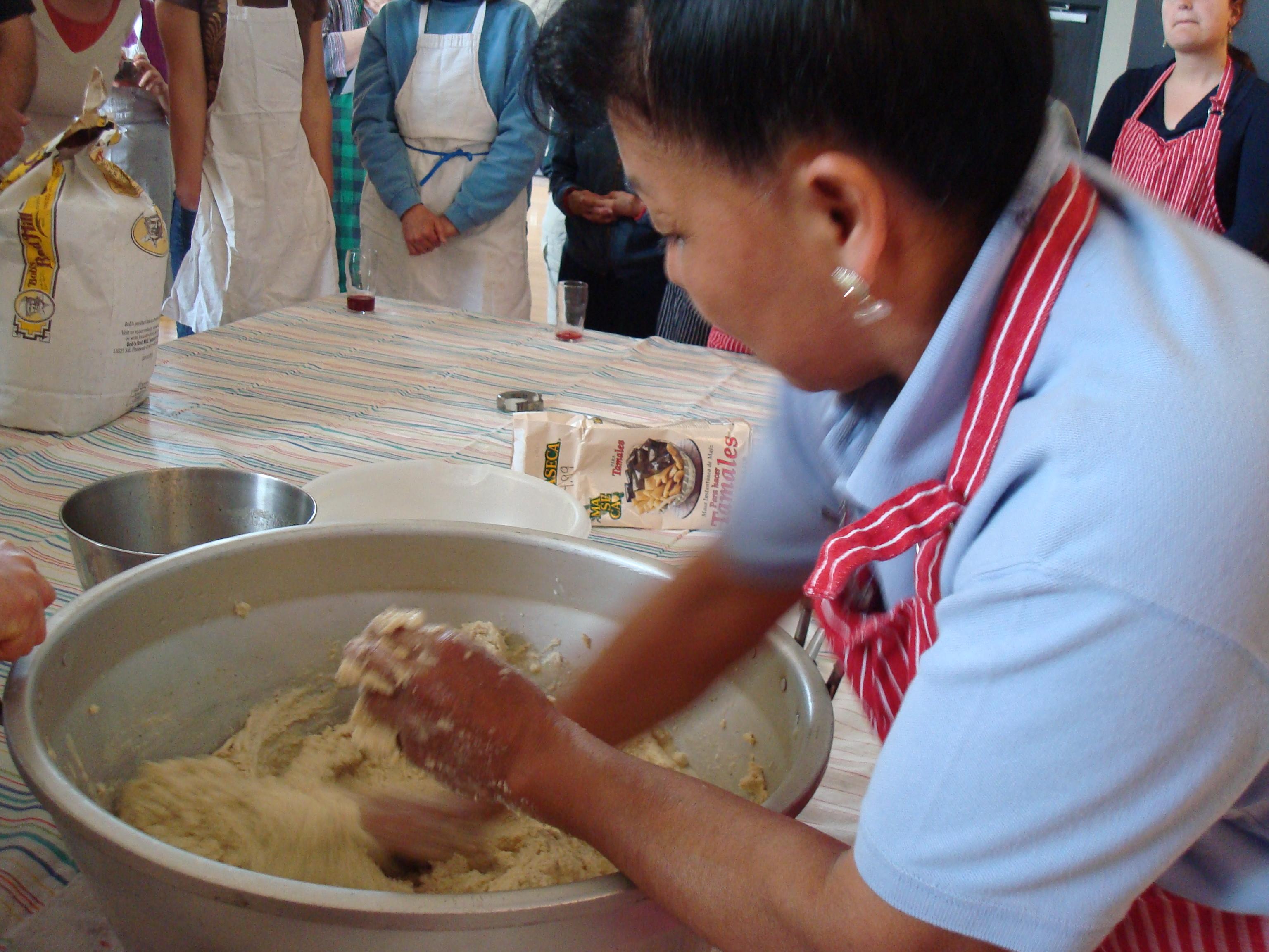 Texcoco native and veteran tamales maker Maria Ortiz demonstrates how to knead the masa dough.