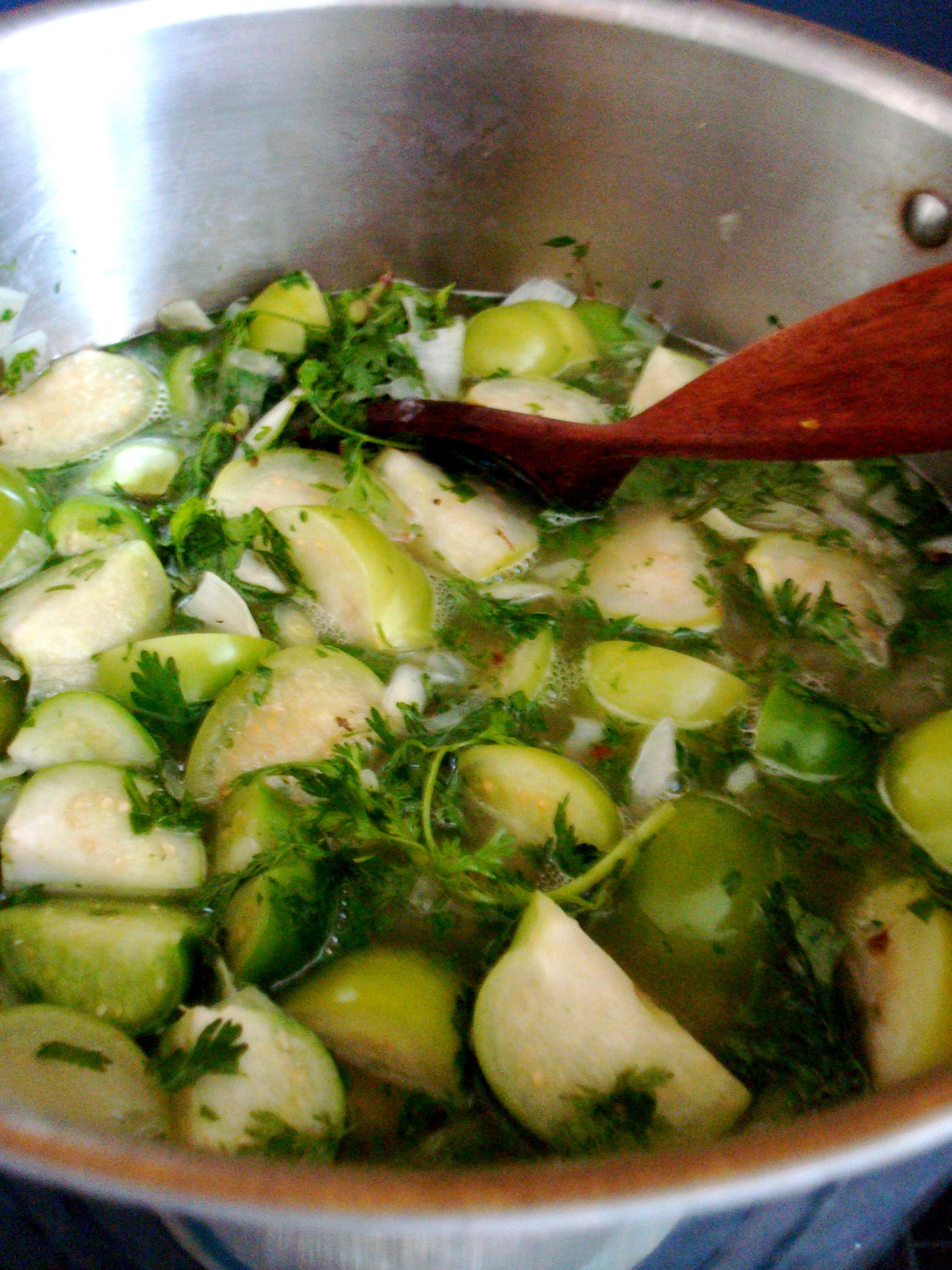Tomatillos simmering into salsa verde.