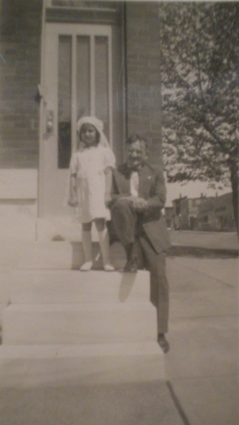 Barbara Duffy with her uncle Fritz Wagner posing on the front steps of 645 S. Kenwood Avenue before her Communion, c. 1947. Barbara's mother was unable to attend because she was ill and her father had passed away in 1946.