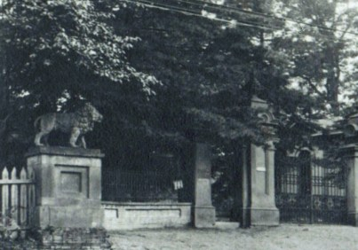Gates to the Guilford Mansion with one of eight lions found on the estate, courtesy the Guilford Association