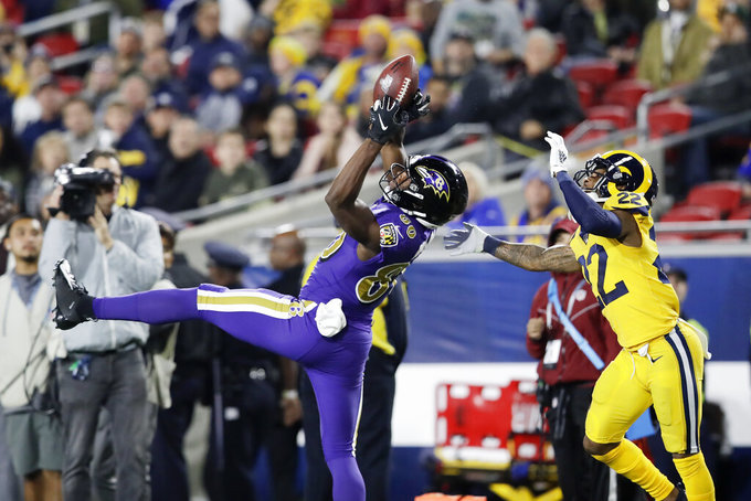 Wolfe doubtful, seven other Ravens questionable while wounded Philadelphia rules out seven