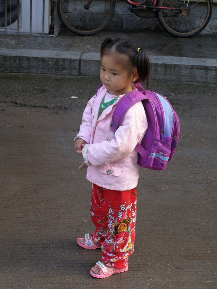 Lttle girl dreaming on her way to school in Southern China