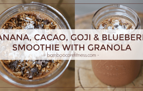 Banana, cacao, goji and blueberry smoothie with granola