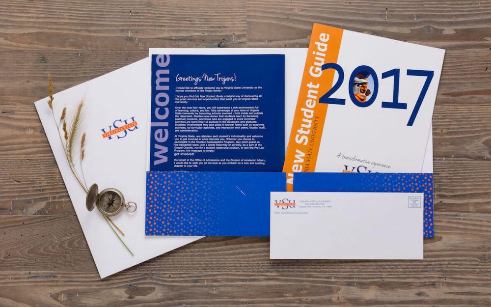 marketing materials for VSU, presentation folder, flyer, and envelope