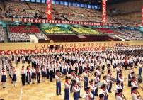 North Korean pupils sing to celebrate th