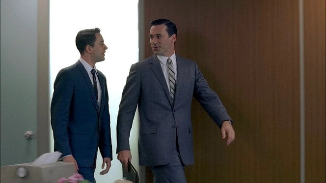 Don looks every bit the classic American businessman as he strides through the office with his groupie, the eager blue-suited Pete Campbell.