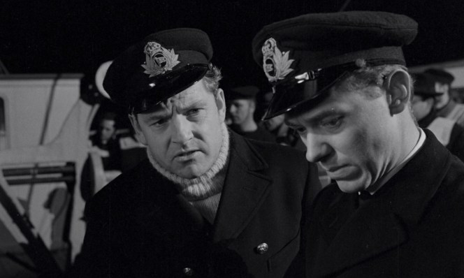 Lightoller and Moody in White Star Line officers' caps during the loading of the final lifeboat to be launched, Collapsible D.