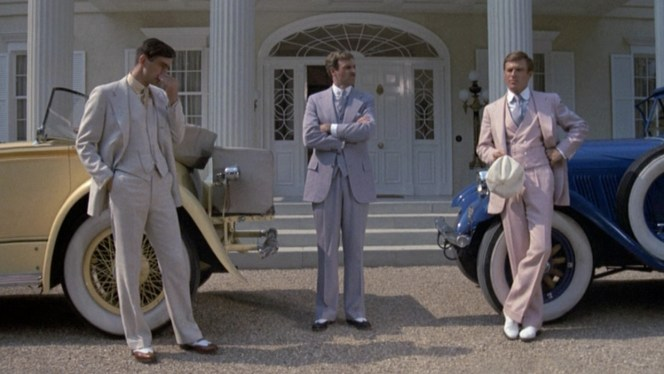 The three main men of the film: Nick Carraway (Sam Waterston), Tom Buchanan (Bruce Dern), and Gatsby. Clothing and postures say a lot in this shot.