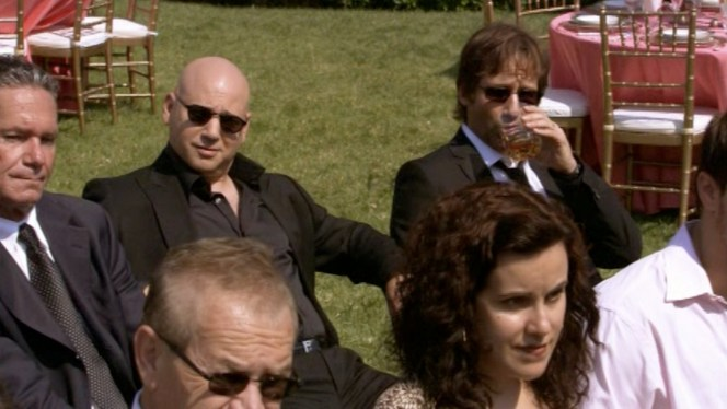 Runkle's ensemble actually looks more like something Hank would wear. Of course, in season 6, Hank does indeed wear something very similar to a funeral.