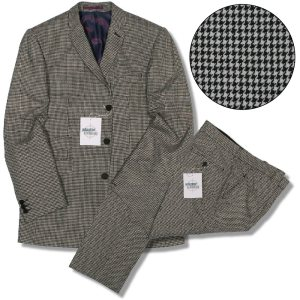 A black and white houndstooth suit offered by Adaptor Clothing of the UK, very similar to something Bond would have worn.