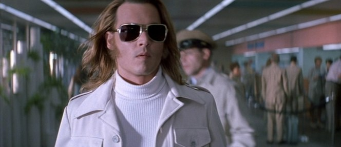 It's a daring look, but most airports have a rule now that if you strut through wearing a white leisure suit and jumper, they have to play