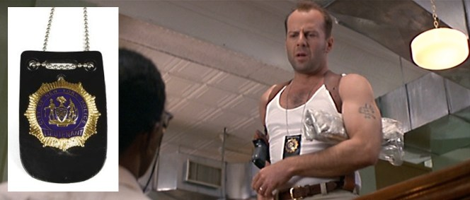 "McClane forgoes the standard police uniform for more of a ""domestic abuser"" look around the office."