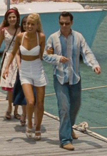 Amber Heard and Johnny Depp as Chenault and Paul Kemp.