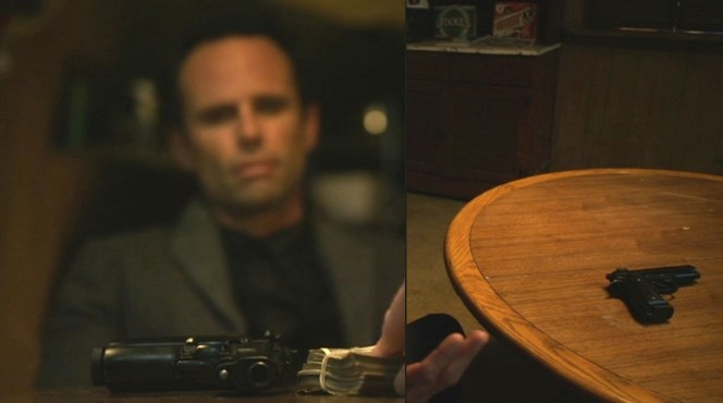 Boyd keeps his Beretta on the table during a meeting with Wynn Duffy.