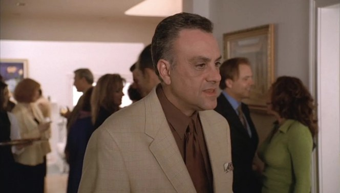 "Johnny Sack greets his guests in ""Employee of the Month"" (Episode 3.04)."