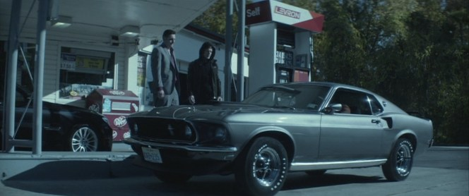 John Wick proudly shows off his '69 Mustang at the gas station, a decision that would come back to haunt both him and his puppy.