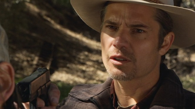 """Raylan draws his Glock to administer justice in """"Bloody Harlan"""" (Episode 2.13)."""