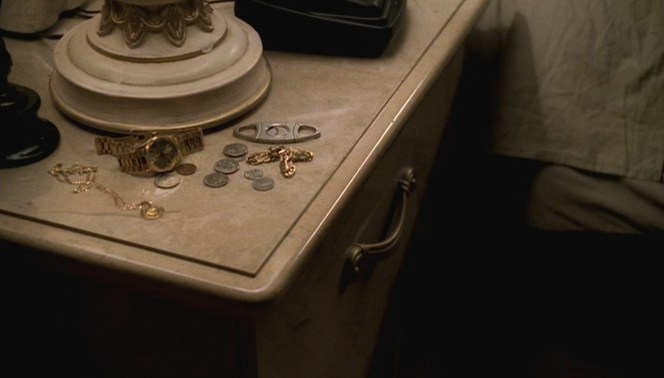 Tony leaves his many gold accessories, including the St. Jerome pendant, on his bedside table with pocket must-haves like loose change and a cigar cutter.