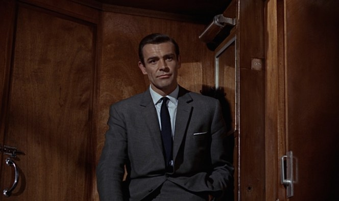 """Bond settles in for a cordial chat with """"Captain Nash""""."""