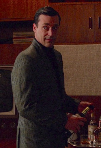 "Dehydrated after an afternoon of salty popcorn, Don Draper (Jon Hamm) turns to his trusty old Canadian Club upon returning home in ""The Quality of Mercy"" (Mad Men, Episode 6.12)."