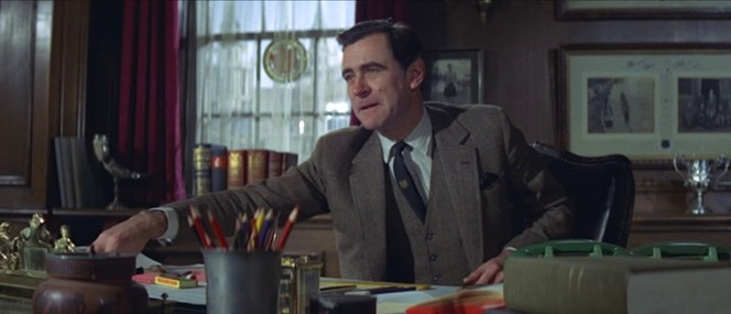 """Sir Hilary Bray's (George Baker) delight about """"getting lost in the churches of Brittany"""" considerably contrasts from Bond's idea of fun."""