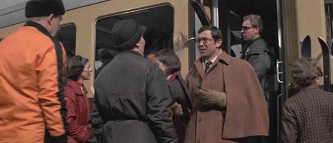 "Irma Bunt ""greets"" Bond as he arrives in Switzerland."