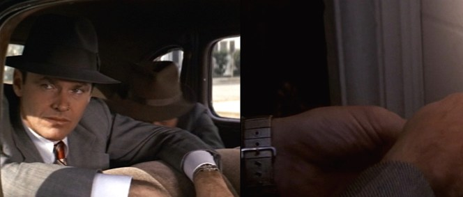 The distinctive buckle of Gittes' watch strap is best seen as he picks a lock.