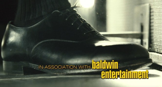"""Ray's footwear also gets some attention during the opening credits. You couldn't ask for a better shot of his oxfords... except maybe without the """"Baldwin Entertainment"""" credit getting in the way."""