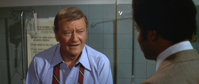 Even John Wayne can get his ass kicked from time to time... he's in the hospital for a full two minutes before he even considers going back out to take on corrupt police officers and drug dealers.