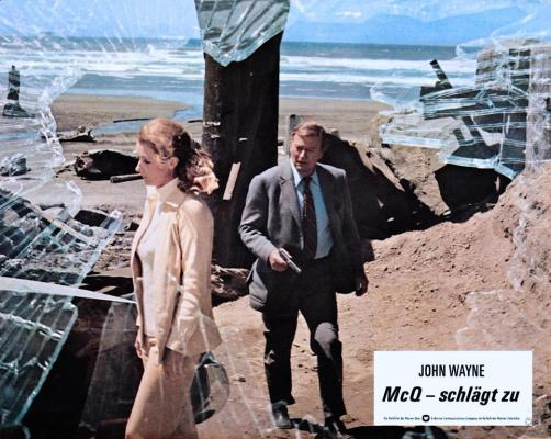 """McQ's footwear is best seen in the promotional shot featured in this German lobby card. Any German-speaking BAMFs out there able to translate """"schlägt zu"""" in this context?"""