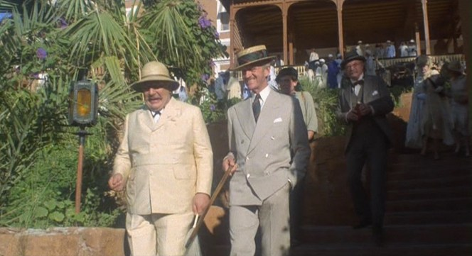 Poirot and Colonel Race prepare for their journey.