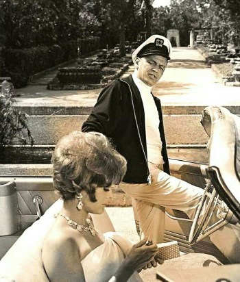 Frank Sinatra slides behind the wheel of a 1961 Ford Galaxie Sunliner with Jill St. John in Tony Rome (1967)