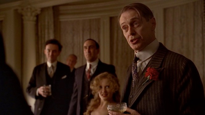 """What Does the Bee Do?"" (episode 2.04): Evidently it's been a long night, as Nucky's hair is a bit tousled but his pale blue striped shirt, white keyhole collar, and purple paisley silk tie remain perfectly in place."