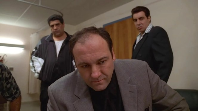 Compared to the track-suited Big Pussy (Vincent Pastore) and disco-couture Silvio Dante (Steven Van Zandt) behind him, Tony looks downright professional.