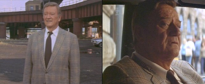 Brannigan sticks to earth tones when sporting a cream OCBD shirt and brown tie with his plaid jacket.