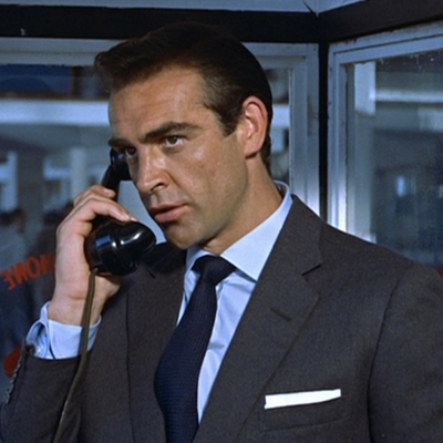 Sean Connery wears a navy Turnbull & Asser grenadine tie in his first 007 film Dr. No.