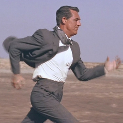 Cary Grant's suit trousers have buckle-tab side adjusters, seen here as he goes for a jog in North by Northwest.
