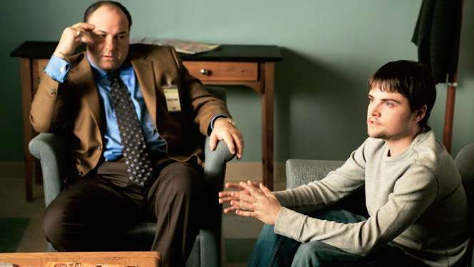 "Production photo of James Gandolfini and Robert Iler at A.J.'s therapy session in ""The Second Coming"" (Episode 6.19). Note the two-button cuffs of Tony's jacket; is this a different jacket than the identical one with four-button cuffs in the first half of the season, or...?"