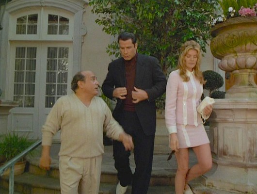 A blink-if-you-miss-it continuity error: Chili's usual black alligator loafers are replaced by these noticeably different off-white shoes in this full shot of Martin, Chili, and Karen leaving the Weir mansion.