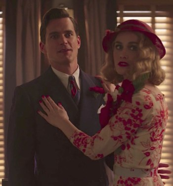 Monroe Stahr (Matt Bomer) and Kathleen Moore (Dominique McElligott), surely to be added to the naughty list after being caught in Monroe's office.