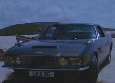The tuxedo-clad Bond left his Aston Martin parked on the beach during the pre-credits sequence.