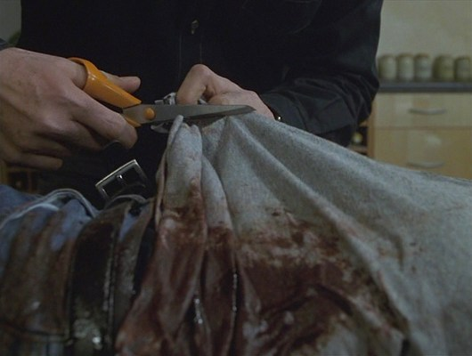 Sam's Calvin Klein t-shirt, torn and bloodied in the gunfight at Arles, is put out of its misery.