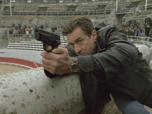 Sam fires his SIG-Sauer P228 during a confrontation at the Arles Amphitheatre.