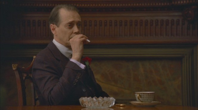 "Nucky flashes his unique turnback cuffs during an afternoon of cigarettes, coffee, and the Commodore's testimony about his near-fatal poisoning in ""A Return to Normalcy"" (Episode 1.12)."